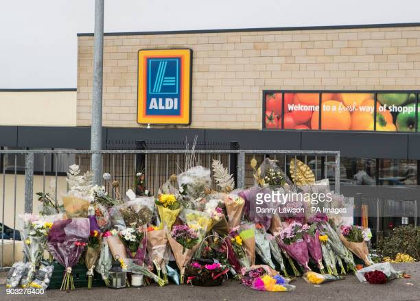Floral tributes outside an Aldi supermarket in Skipton where Jodie Willsher was stabbed to death ahead of her funeral that takes place in the town