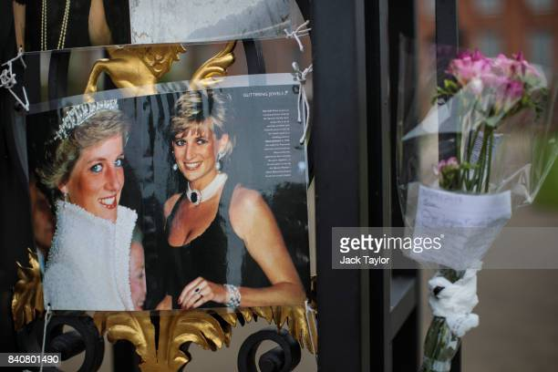 Floral tributes photographs and messages sit on an entrance gate to Kensington Palace ahead of the 20th anniversary of the death of Diana Princess of...