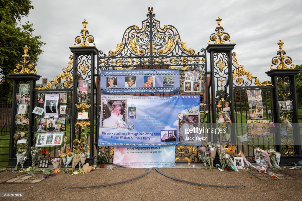 Floral tributes, photographs and messages sit outside an entrance gate to Kensington Palace ahead of the 20th anniversary of the death of Diana, Princess of Wales on August 30, 2017 in London, England. On August 31, 1997 Princess Diana was fatally injured, aged 36, in a high speed car crash in a Paris, France. The months following her death saw a huge public outpouring of grief with a sea of tributes left by members of the public outside Kensington Palace.