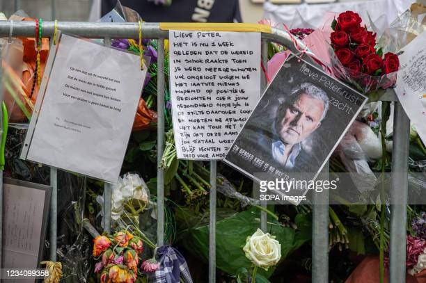 Floral tributes, pictures and messages for murdered Dutch investigative journalist Peter R. De Vries are seen displayed on Leidsedwarsstraat street....