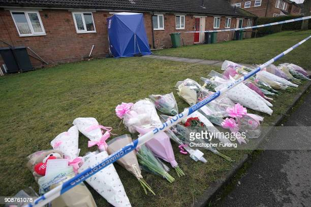 Floral tributes stand outside a home in Valley View Brownhills Walsall where Mylee Billingham aged eight was stabbed and later died in hospital on...