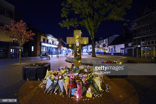 Floral tributes surround the base of the Eccles Cross for murdered british aid worker Alan Henning in Eccles in Greater Manchester northwest England...