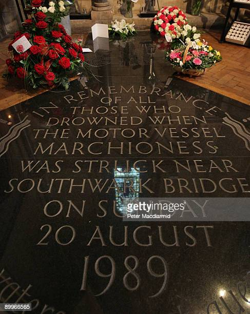Floral tributes surround the memorial to the victims of the Marchioness disaster at Southwark Cathedral on August 20 2009 in London England The...