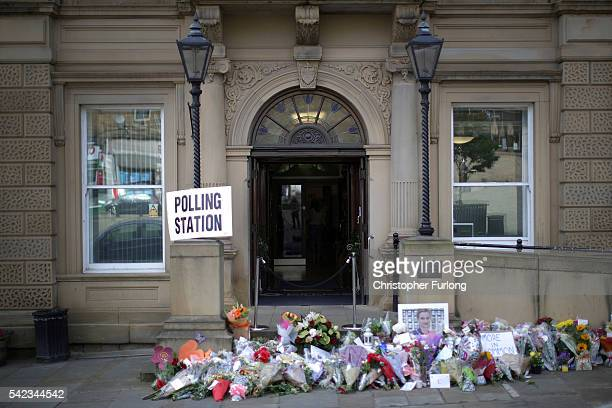 Floral tributes to Jo Cox MP adorn Batley Town Hall as people cast their votes in the EU referendum on June 23 2016 Batley United Kingdom One week...