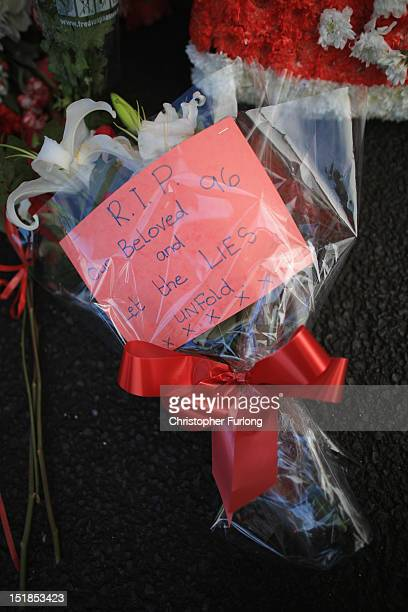 Floral tributes to the victims of the Hillsborough disaster are place at the Hillsborough memorial at Anfield stadium after the publication of the...