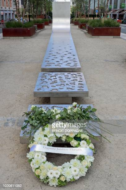 A floral wreath leans against a bench after a tribute ceremony held to mark the first international day for victims of terrorist attacks at The...