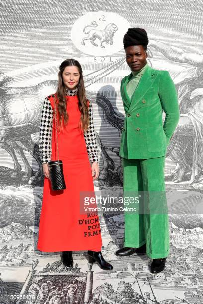 Florence and Benjamin Clementine arrive at the Gucci show during Milan Fashion Week Autumn/Winter 2019/20 on February 20 2019 in Milan Italy