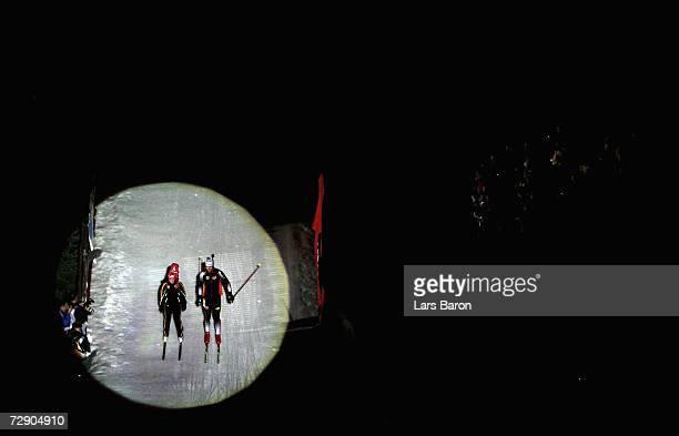 Florence Baverel and Julien Robert of France are displayed in the spotlights during the Veltins Biathlon World Team Challenge 2006 at the Veltins...