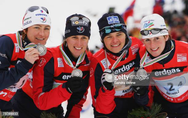 Florence BaverelRobert Delphine Peretto Sylvie Becaert and Sandrine Bailly of France present their silver medal of the Women's 4 x 6 km Relay in the...