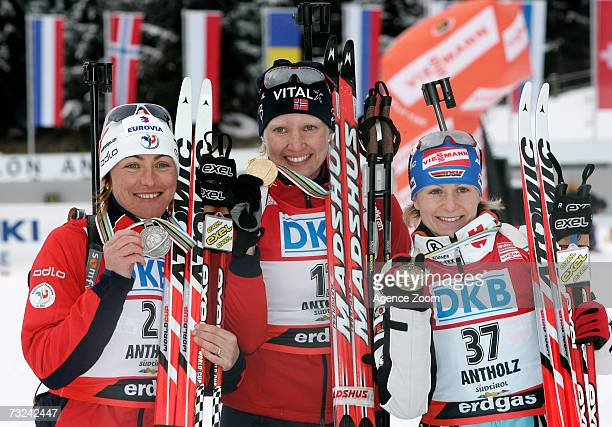 Florence BaverelRobert of France Linda Grubben of Norway and Martina Glagow of Germany celebrate winning their medals for the Women's 15 km...