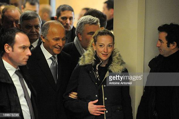 Florence Cassez and French Foreign minister Laurent Fabius arrive for a press conference at the Roissy airport on January 24, 2013 in Paris, France....