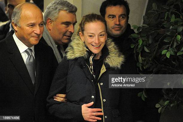 Florence Cassez and French Foreign minister Laurent Fabius arrive for a press conference at the Roissy airport on January 24 2013 in Paris France A...