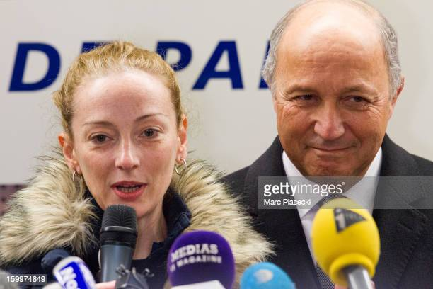 Florence Cassez speaks to members of the media next to French Foreign Minister Laurent Fabius during a Press conference following her release from...