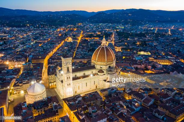 florence cathedral and the historic city of florence at dusk. (dusk) - duomo santa maria del fiore stock pictures, royalty-free photos & images