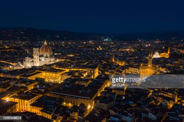 florence cathedral and the historic city of florence at dusk. (dusk) - florence italy foto e immagini stock