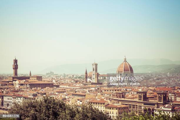 florence cathedral in city against sky - andre wilms eyeem stock-fotos und bilder