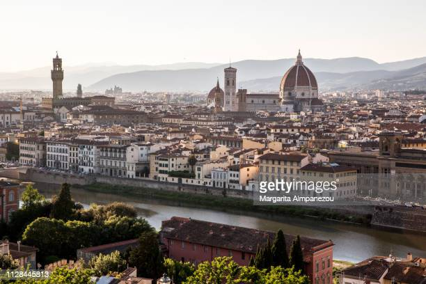 florence city from above with views of arno river and the cathedral of santa maria del fiore - arno stockfoto's en -beelden