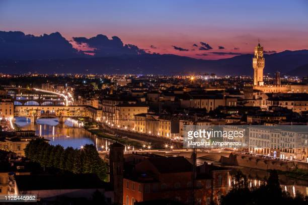 Florence city view of Arno river, Ponte Vecchio and Palazzo Vecchio by night