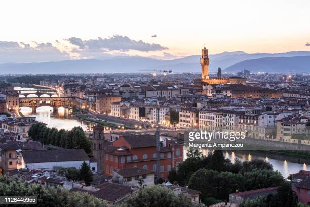 Florence city with views of Arno river, Ponte Vecchio and Palazzo Vecchio from above