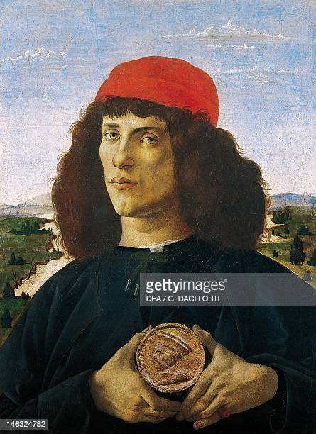 Florence Galleria Degli Uffizi Portrait of a Man with a Medal of Cosimo the Elder ca 1474 by Sandro Botticelli tempera on wood5x44 cm