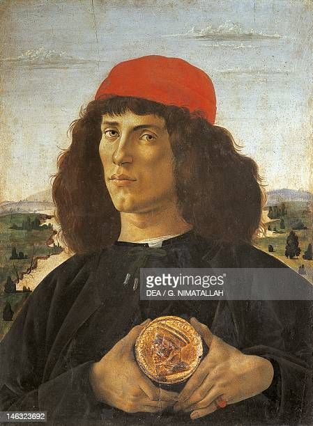 Florence Galleria Degli Uffizi Portrait of a Man with the Medal of Cosimo de Medici the Elder Sandro Botticelli tempera on wood 57x44 cm