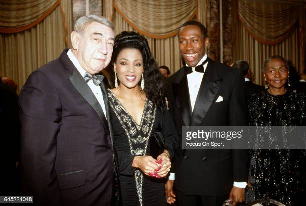 Florence Griffith Joyner and husband Al Joyner with sports announcer Howard Cosell circa 1988