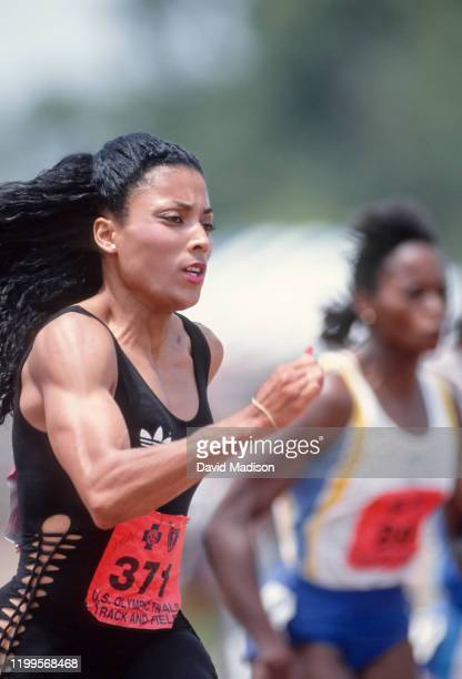Florence Griffith Joyner of the USA competes in the preliminary rounds of the Women's 100 meter event of the 1988 USA Track and Field Olympic Trials...