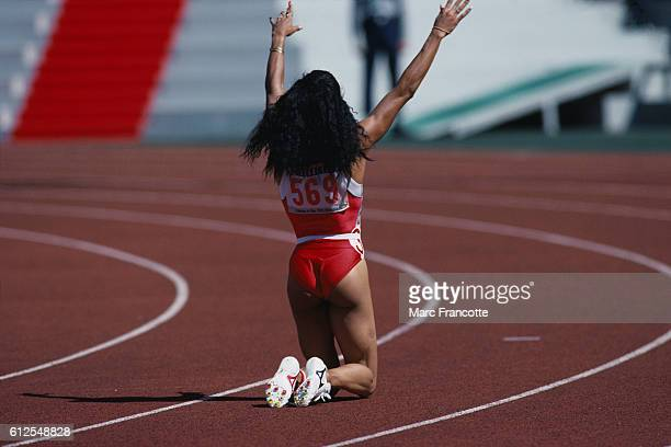 Florence Griffith Joyner waves to the crowd after winning the women's 100meter dash at the 1988 Olympics