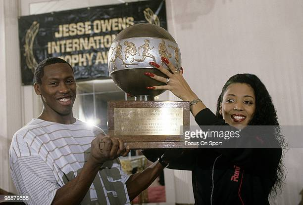Florence Griffith Joyner with her husband AL Joyner holding the 'Jesse Owens International Awards Trophy' presented to her by the International...