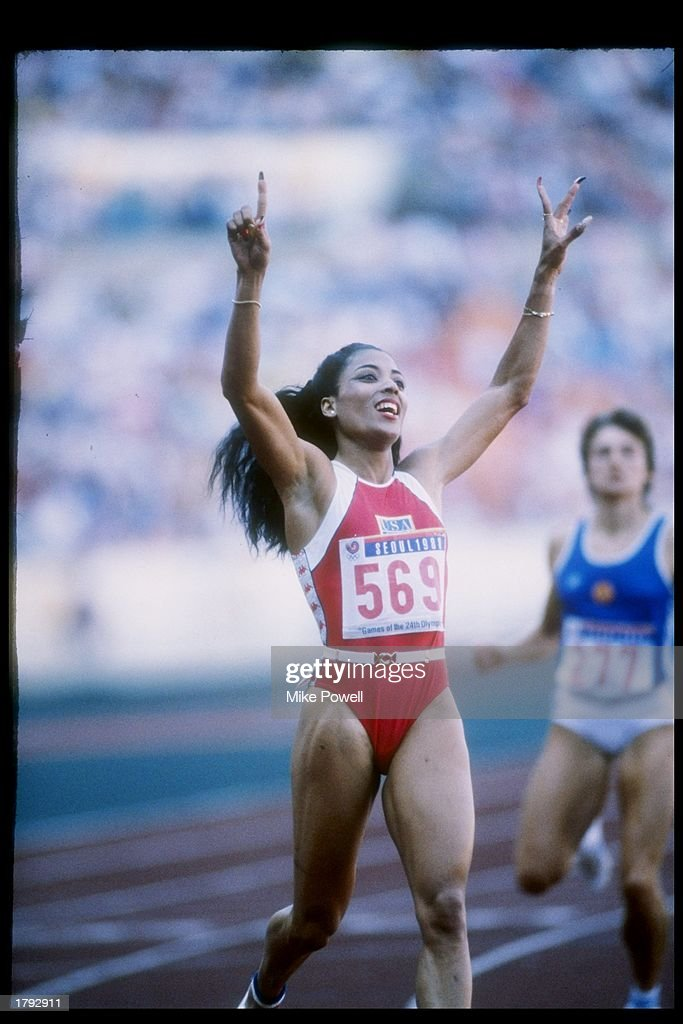 Florence Griffith-Joyner celebrates after winning a race during the Olympic Games in Seoul, South Korea. Mandatory Credit: Mike Powell /Allsport