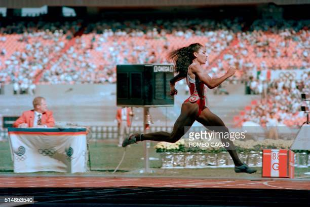 US Florence GriffithJoyner competes during the women's 200m semifinal at the athletics event of the Seoul 1988 Olympic Games on September 29 in Seoul...