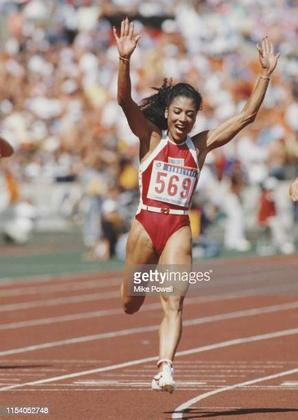 Florence Griffith-Joyner of the United States celebrates winning gold in the Women's 100 metres final event during the XXIV Summer Olympic Games on...