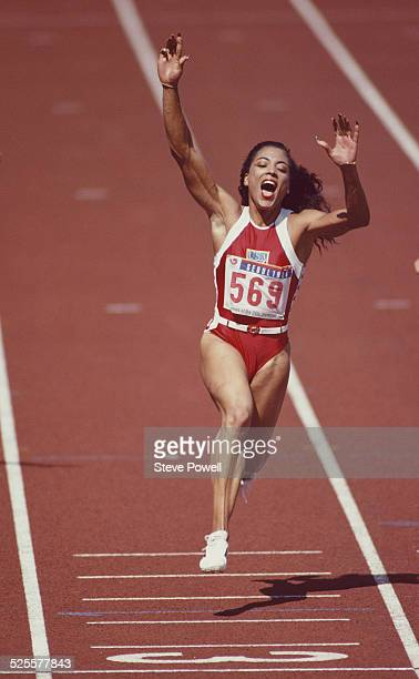 Florence GriffithJoyner of the United States celebrates winning gold in the Women's 100 metres final on 25 September 1988 during the XXIV Olympic...