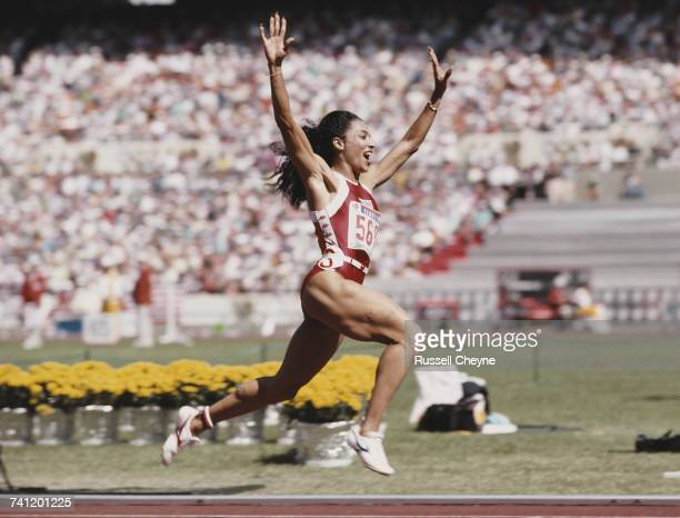 Florence GriffithJoyner of the United States celebrates winning gold in the Women's 100 metres final event during the XXIV Summer Olympic Games on 25...