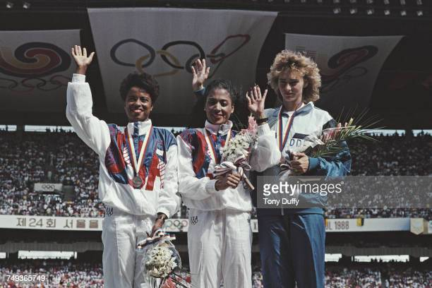 Florence GriffithJoyner of the United States celebrates winning the gold medal in the Women's 100 metres final event with second placed silver...