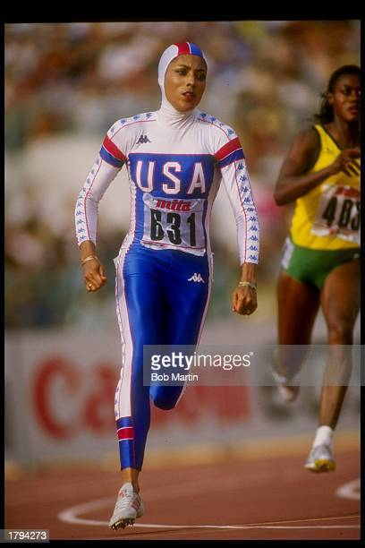Florence GriffithJoyner runs down the track during a track meet in Rome Italy