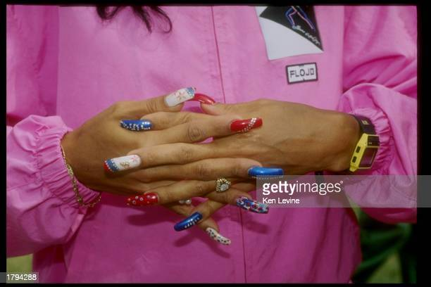 Florence GriffithJoyner shows her nails during the 1991 Sports Festival