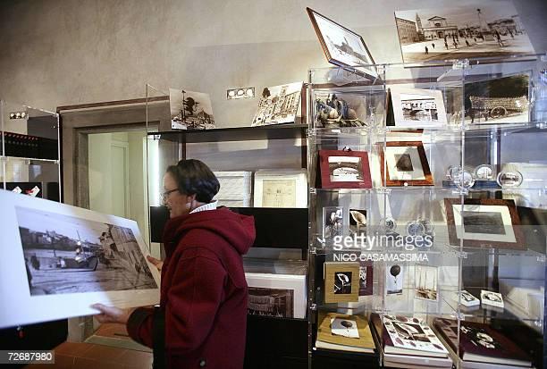 POUR ILLUSTRER LE PAPIER Ouverture a Florence d'un musee national italien de la photographie A woman is pictured in the shop of the new Mnaf Alinari...