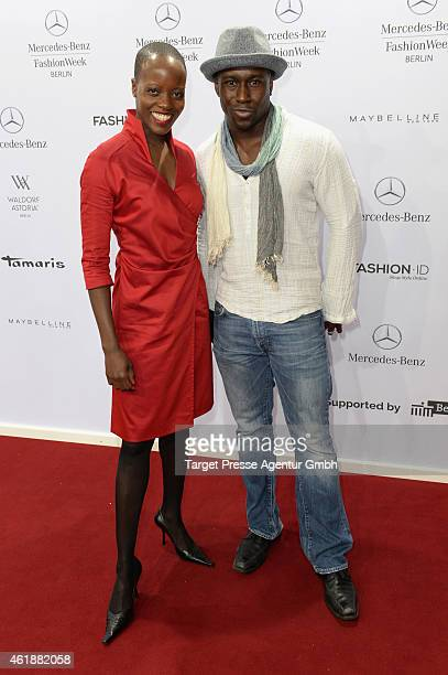 Florence Kasumba and Jerry Kwarteng attends the Glaw show during the MercedesBenz Fashion Week Berlin Autumn/Winter 2015/16 at Brandenburg Gate on...