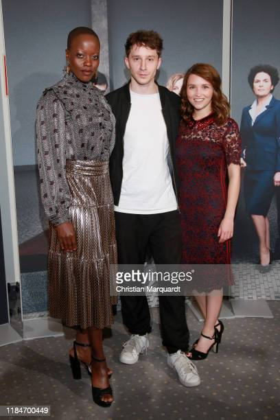 """Florence Kasumba, Jonathan Berlin and Janina Fautz attend the premiere of the movie """"Der Preis der Freiheit"""" at Stasi Zentrale on October 31, 2019 in..."""