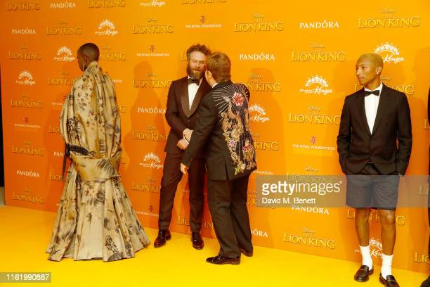 Florence Kasumba Seth Rogen Elton John and Pharrell WIlliams attend the European Premiere of The Lion King at Odeon Luxe Leicester Square on July 14...