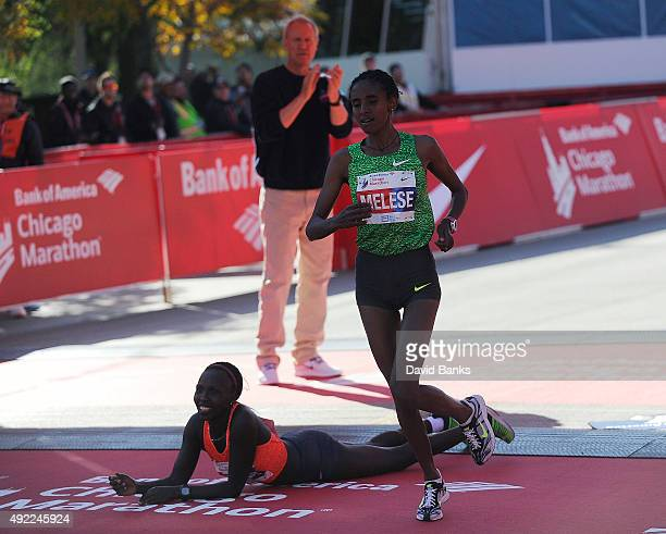Florence Kiplagat of Kenya crosses the finish line to win the women's 2015 Bank of America Chicago Marathon as Yebrgual Melese of Ethiopia finishes...