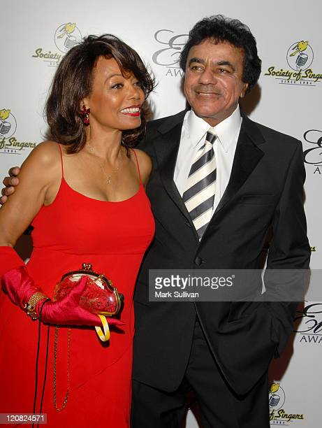 Florence LaRue and Johnny Mathis during The Society of Singers Presents the 15th Annual Ella Award to Johnny Mathis Arrivals at Beverly Hilton Hotel...