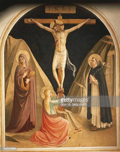 Florence Museo Di San Marco Mary Magdalene at the feet of crucified Christ 14371445 by Giovanni da Fiesole known as Fra Angelico fresco Cells of the...