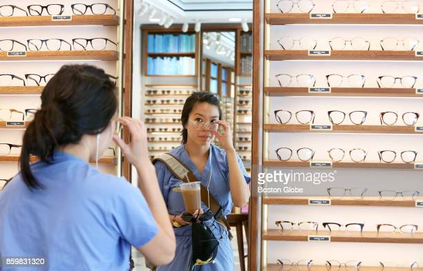 Florence On of Cambridge tries on frames at the Warby Parker store at 39 John F Kennedy Street in Harvard Square in Cambridge MA on Oct 3 2017
