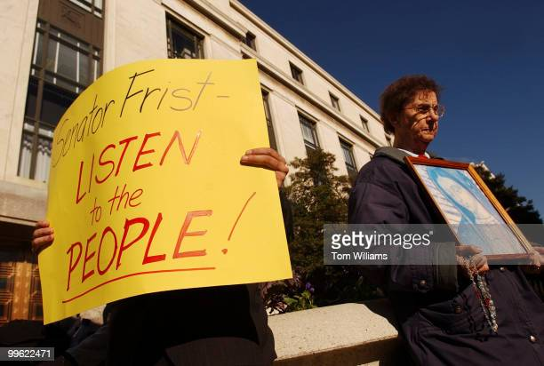 Florence Pasco holds a picture of the Madonna at a protest by relgious groups opposing the nomination of Sen Arlen Specter RPa for the chairmanship...