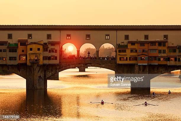 florence,  ponte vecchio over the arno river - ponte vecchio stock photos and pictures