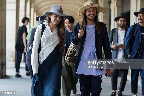 Florence ProvencherProulx and hat designer Isaac Larose exit the Lemaire show in Larose Paris hats on June 24 2015 in Paris France