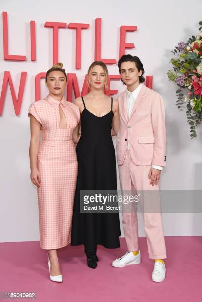"""Florence Pugh, Saoirse Ronan and Timothee Chalamet pose at the evening photocall for """"Little Women"""" at The Soho Hotel London on December 16, 2019 in..."""