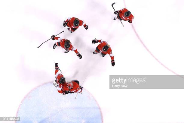 Florence Schelling of Switzerland celebrates with teammates after defeating Japan 10 during the Women's Ice Hockey Classification game on day eleven...